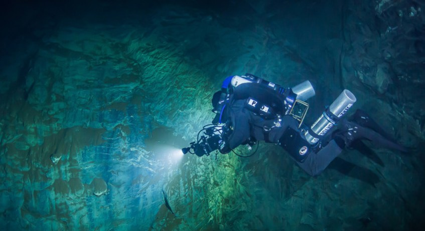 In this underwater photo taken Aug. 15, 2015 in the flooded Hranicka Propast, or Hranice Abyss, in the Czech Republic Polish explorer Slawomir Packo is exploring the limestone abyss and preparing for deeper exploration with the use of a remotely-operated underwater robot, or ROV. On Sept. 27, 2016, the robot went to the record depth of 404 meters (1,325 feet) revealing the abyss to be the world's deepest flooded cave, during the 'Hranicka Propast - step beyond 400m' expedition led by Polish explorer Krzysztof Starnawski and partly funded by the National Geographic. (Krzysztof Starnawski of EXPEDITION via AP)