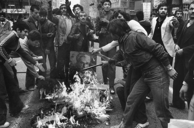 Tehran, December 1978_Rioters burn a portrait of the shah