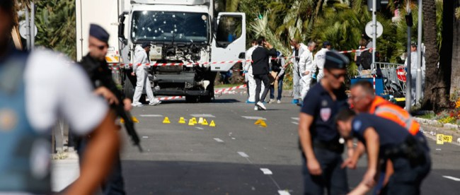 French police secure the area as the investigation continues at the scene near the heavy truck that ran into a crowd at high speed killing scores who were celebrating the Bastille Day July 14 national holiday on the Promenade des Anglais in Nice, France, July 15, 2016. © Eric Gaillard / Reuters