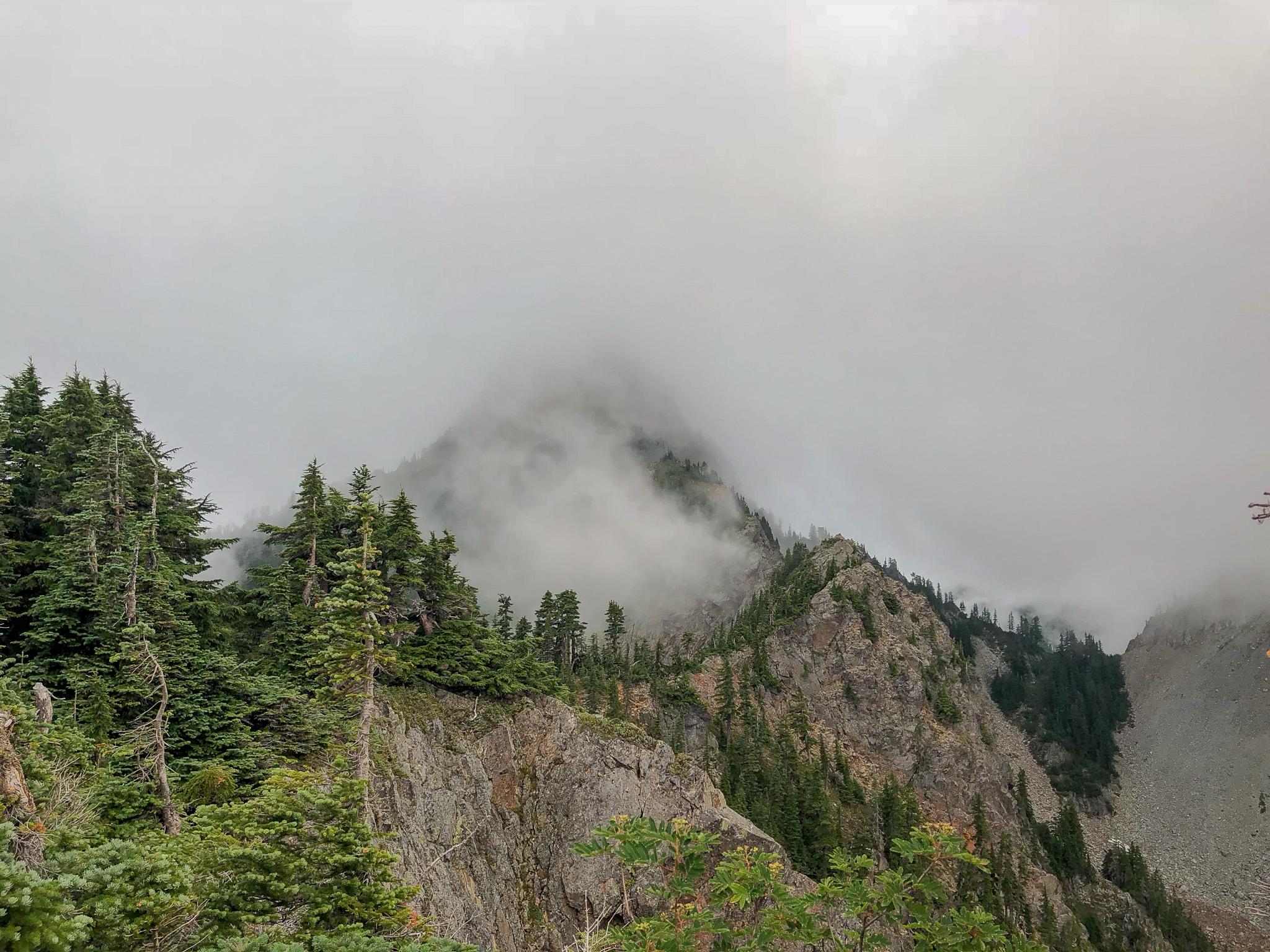 Kaleetan, obscured by clouds.