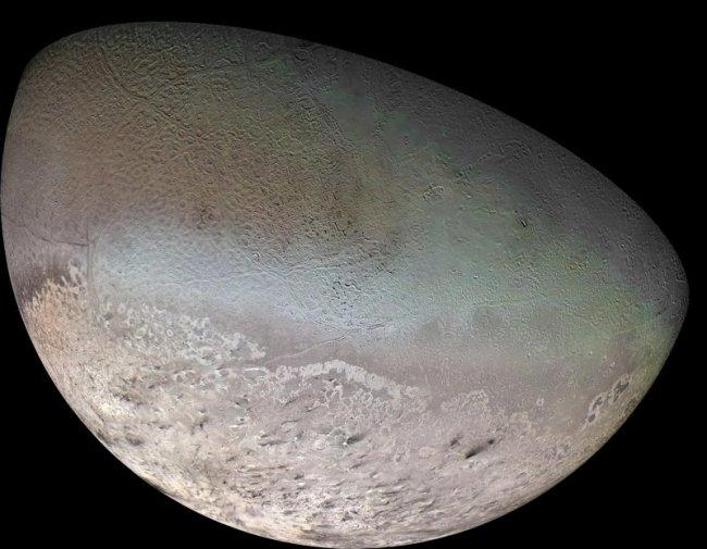 TTriton, maan van Neptunus, gefotografeerd voor de Voyager 2
