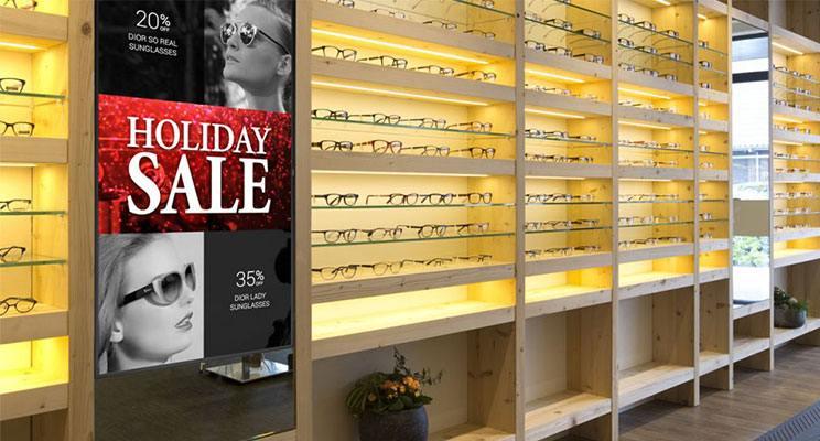 Digital signage promoting a holiday sales at an eyeglass retailer