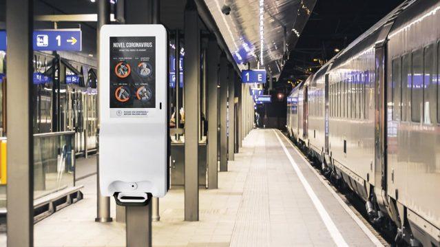 Digital hand sanitizer kisok, at train station, public transport