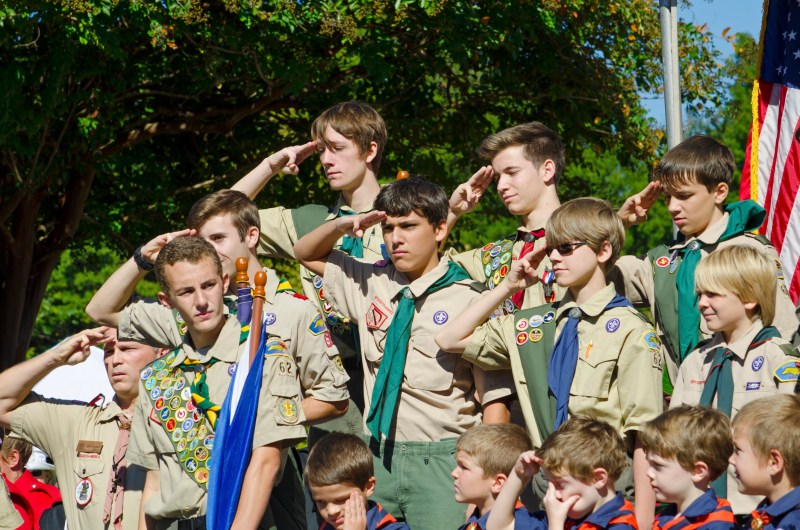 Belmont, North Carolina, USA - October 4, 2014: A group of Boy Scouts of America from Troop 62 stands at attention to North Carolina Governor, Pat McCrory during a speech dedicating a statue to honor the Veterans of World War II. The Boy Scouts of America (BSA) was founded in 1910 and has 2.7 million youth members.