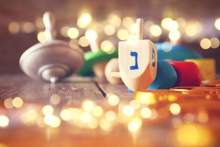 Image of jewish holiday Hanukkah with wooden dreidels