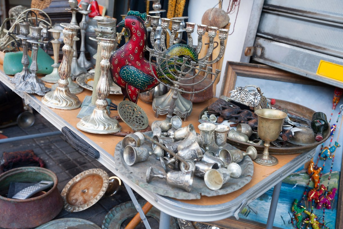 A table with Kiddush Cups, candle holders, Menorah and other Jewish items for sale at the flea market in Jaffa (Yaffo), Tel Aviv, Israel.