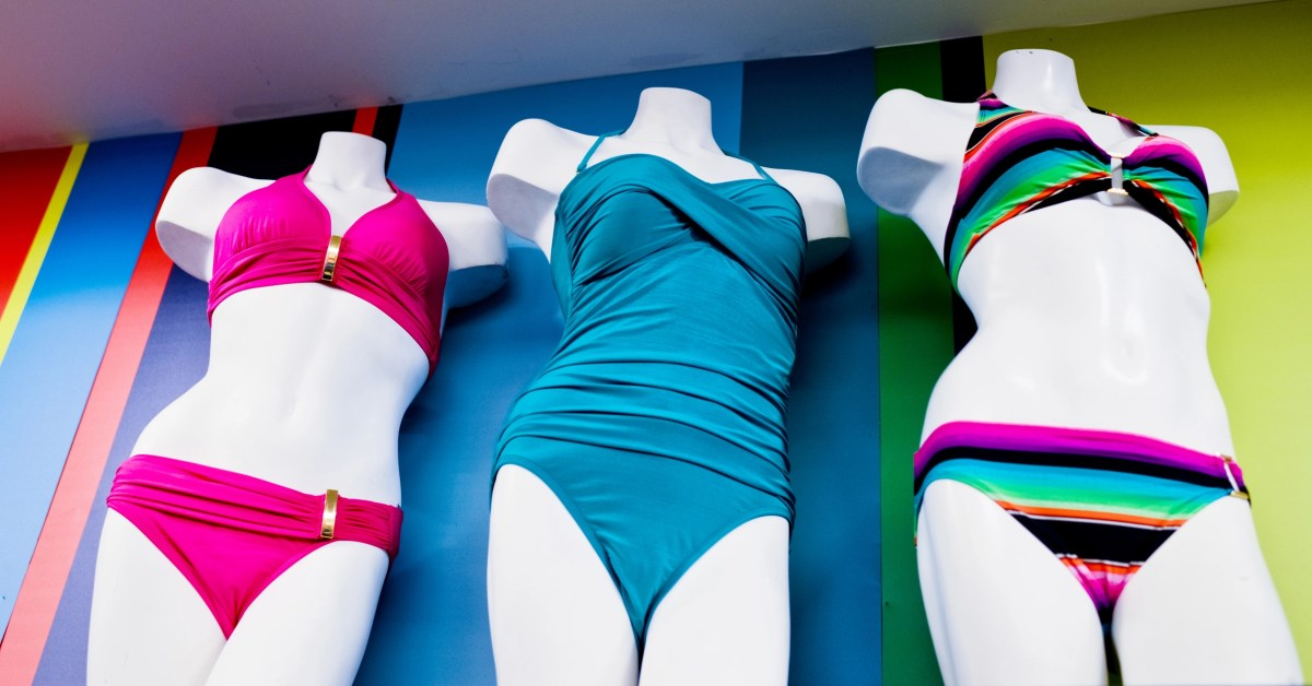 Mannequins wearing swimwear in a clothing store