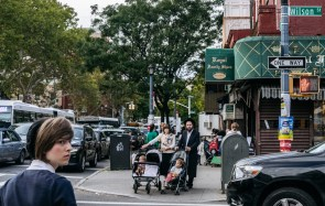 New York, USA - September 22, 2015: Jewish hassidic pair cross the street.