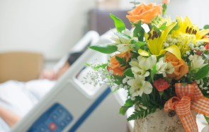 Beutiful bouquet of flowers next to a hospital bed. Get well soon flowers