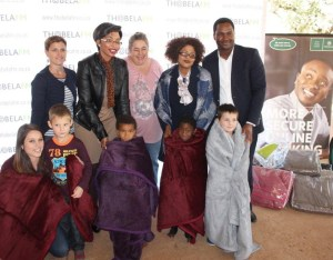 The personnel of Nedbank handing over the winter blankets to the Thabazimbi Special needs school on 17 June.