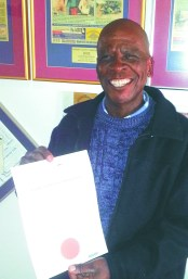 Madimetja Piet Mosetlha standing proud with his certificate that he received from Unisa on 29 May 2014.