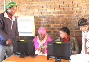Mr Thabo Mogapi, a resident of Northam paying for his services at Northam TLC offices, he is assisted by  TLM officials, Pauline Chirwa, Tebogo Kibinyane and Moipone Pholoba during debt collection campaign.