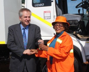 Mr Phillip Schoeman, General Manager of Anglo American Platinum Union mine handing over keys of brand new refuse removal truck to Mayor Patricia Mosito of Thabazimbi Local Municipality during Mandela Day held recently in Northam.