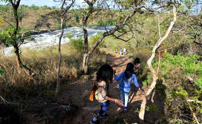 Tourists hike on the Bakers Trail along the Nile River in Murchison Falls National Park, Uganda-travel with Kwezi Outdoors