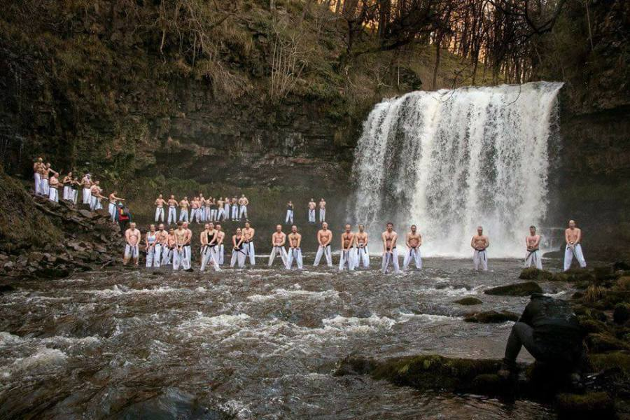 martial artists take welsh waterfall