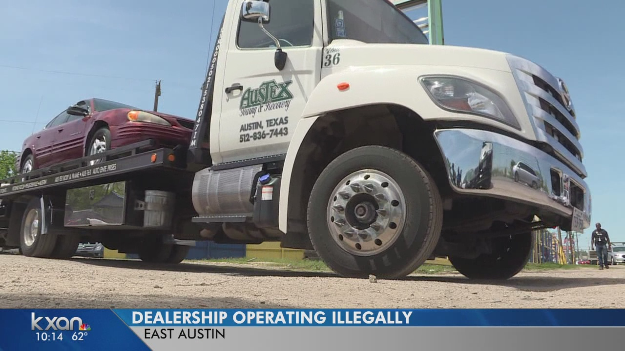 Police tow cars from dealership operating illegally