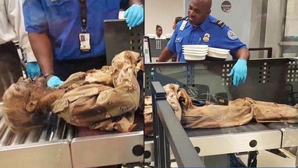TSA inspecting the zombie prop - WJBF_289897
