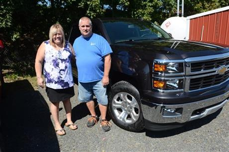 In this Sept. 17, 2015 photo, Joan Lechleitner and Kerry Titus, both of Pottsville, stand next to the 2015 Chevrolet Silverado 1500 Z71 the cou_293337
