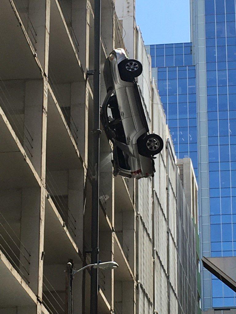 Vehicle dangling from Littlefield Garage_345804