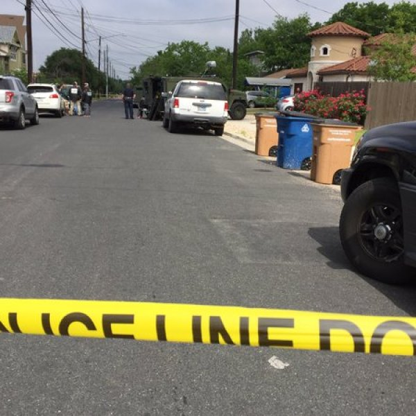 Authorities at the scene of the officer involved shooting on Morrow Street. (KXAN Photo)_271399