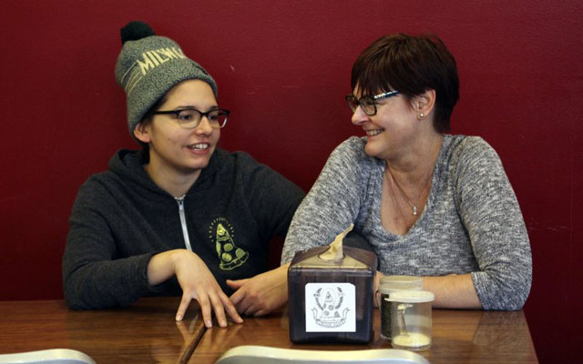 In this Jan. 9, 2017, photo, Andrea Ledesma, left, talks with her mother, Cheryl Romanowski, at Classic Slice pizza restaurant, where Ledesma w_399522