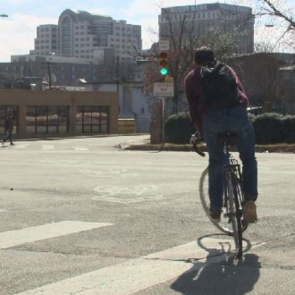 A bicyclist makes his way across an intersection in downtown Austin_401564