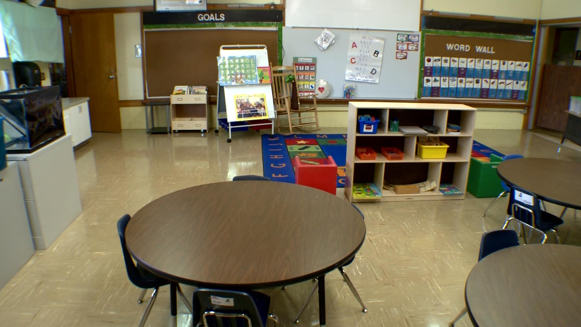 empty pre-k classroom + one blurry kids shot_649876