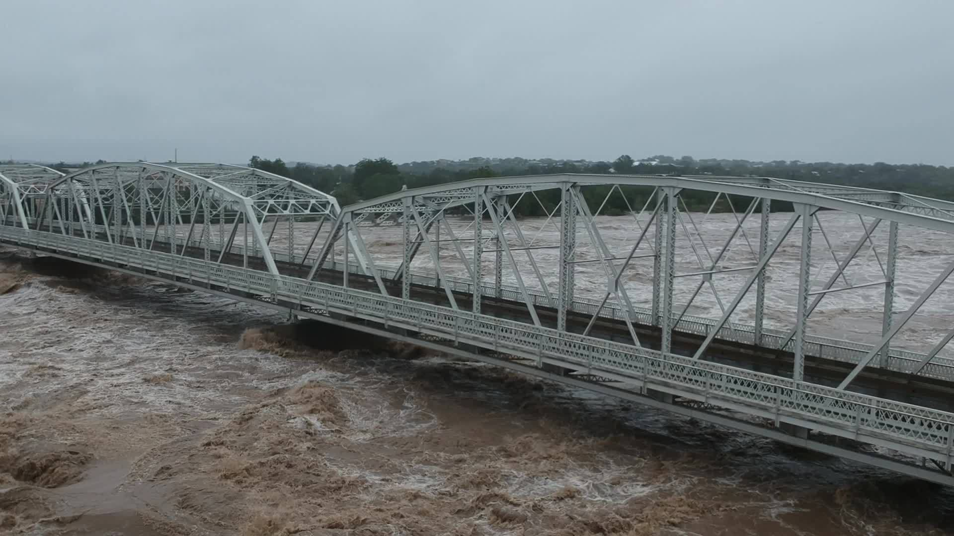 Floodwaters under Inks Bridge in Llano on Oct. 16, 2018