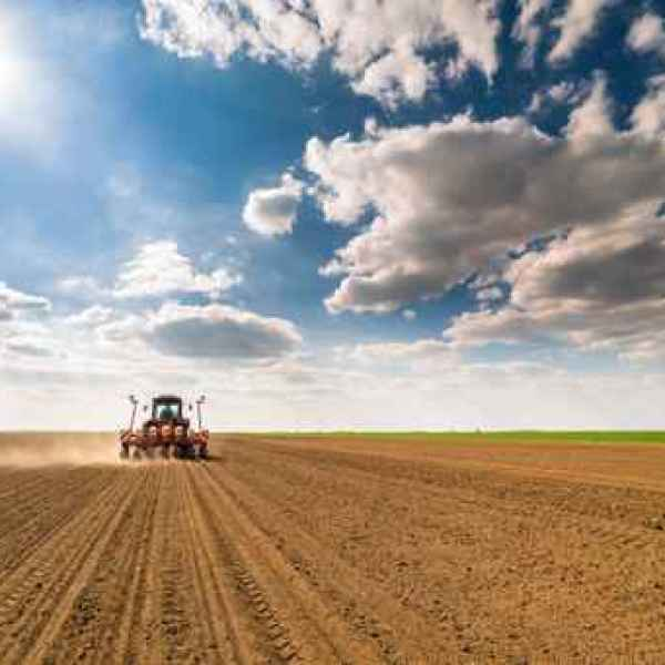 Farmer seeding, sowing crops at field. Sowing is the process of _1557407062132