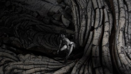Naked woman in the shadow of lava trees by Kyesos