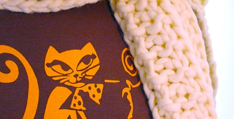 Close up on a smoking cat printed on cloth and scarf by Kyesos
