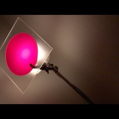 Ambiance pink spot light with shadows on the wall by Kyesos