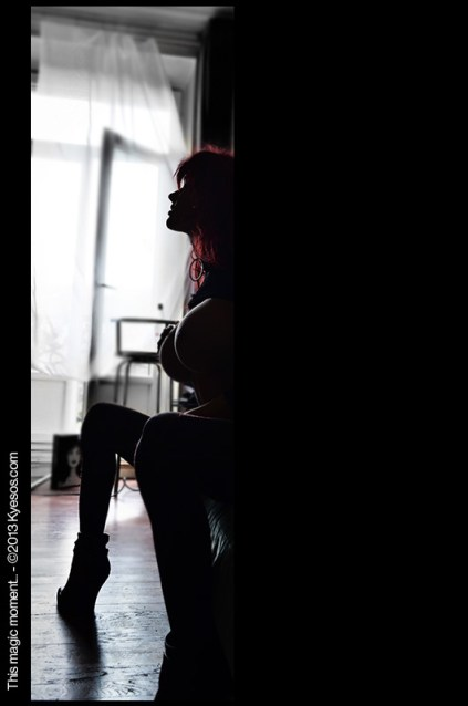 Gorgeous redhead female model partially revealed from shadow by a smooth light by Kyesos