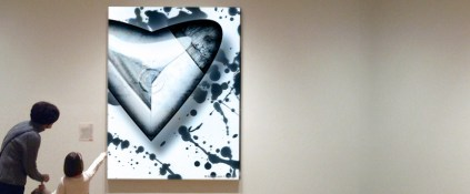 Mum and daughter in front of a huge Kyesos heart shaped artwork painting sticked on the wall