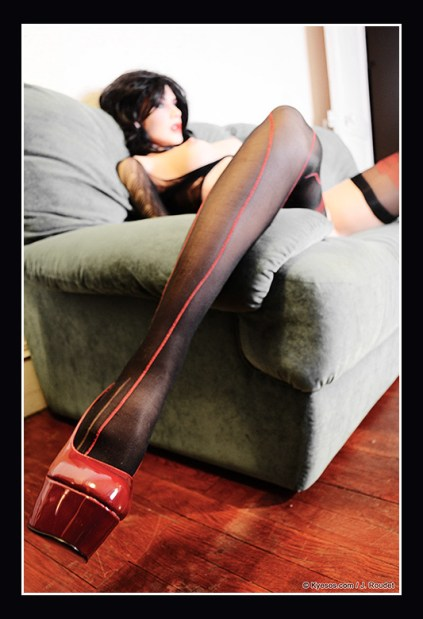 Nice pinup in a sofa with deep perspective from shoe