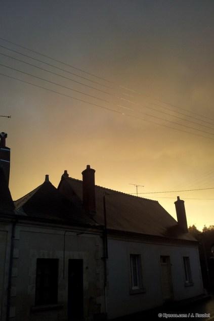 house under a stormy sky