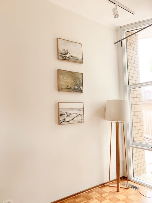 Three golden drawings beautiful installed in the owners home beside a lamp