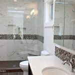 Walk In Shower In Bathroom With Pink And Brown Mosaic Tile Marble Look Shower Surround White Quartz And Cloud White Walls
