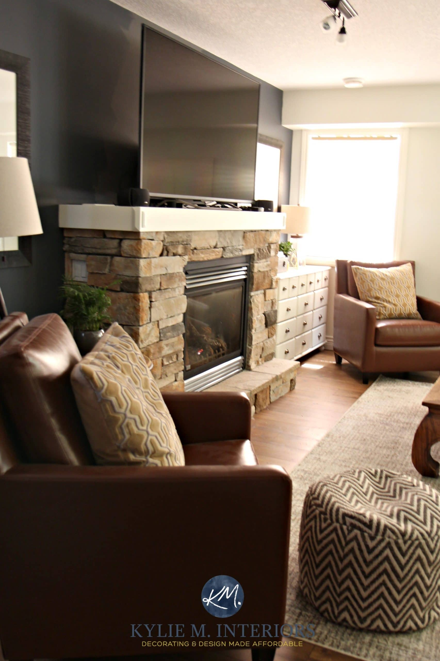 Family Room With Tv On Mantel Above Stone Fireplace With 2