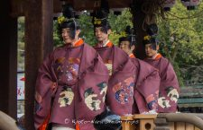 The Yasaka Gagaku-kai (弥栄雅楽会) dancers leaving the kaguraden after their performance of a sacred Bugaku (舞楽) court dance to the tunes of ancient music, during the annual Setsubun festival at Yasaka shrine in Kyoto. They are wearing intricate traditional Buddhist costumes.