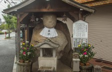 The famous Koyasu-Bodhisattva (子安観世音) statue on the corner of Imadegawa Dori (今出川通) and Shigagoe-michi (志賀越道) near Hyakumanben (百万遍),  Sakyō-ku, Kyōto. This Jizo statue stands 2 meters tall and was hewed out granite.