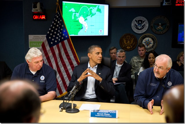 President Barack Obama receives an update on the ongoing response to Hurricane Sandy  at the National Response Coordination Center at FEMA headquarters in Washington, D.C., Sunday, Oct. 28, 2012. FEMA Administrator Craig Fugate and Richard Serino, FEMA Deputy Administrator, are seated next to the President. (Official White House Photo by Pete Souza)