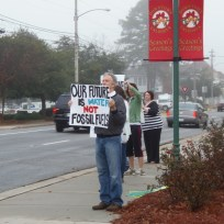 Our Future is Water, Not Fossil Fuels, Matthew Richard, Karen Noll, Andi Ray Drake, in No pipeline no fracking: protest before Spectra at Lowndes County Commission, by Gretchen Quarterman, for Lowndes Area Knowledge Exchange (LAKE), 9 December 2013