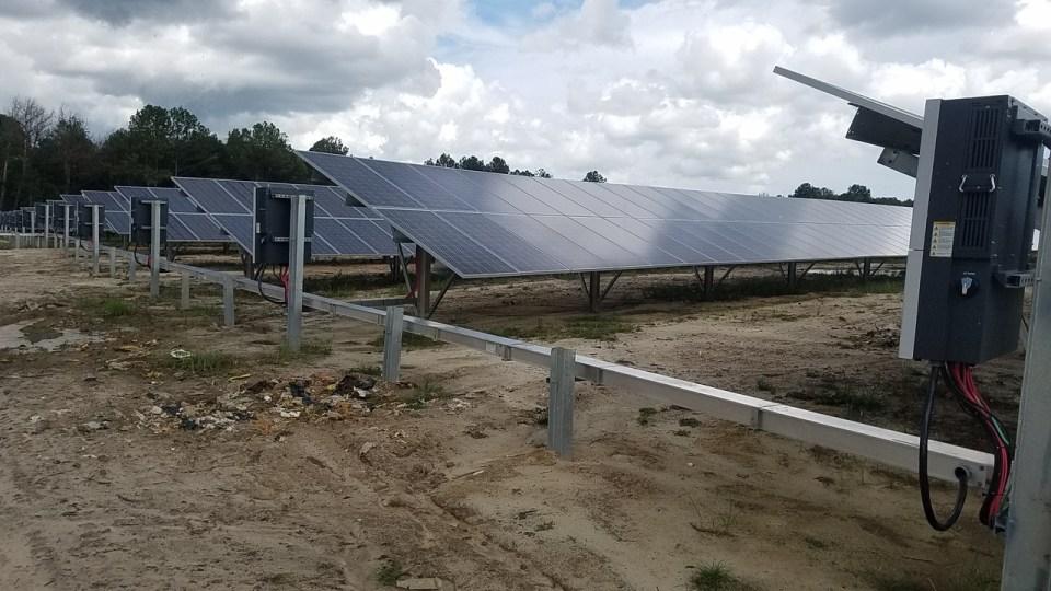 1280x720 Trash and solar panels, in Valdosta Solar Power on Val Tech Road, by John S. Quarterman, 1 September 2017