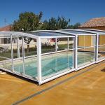 Abri piscine haut télescopique modèle Athènes de Bel Abri