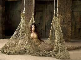 A female model sitting around a net