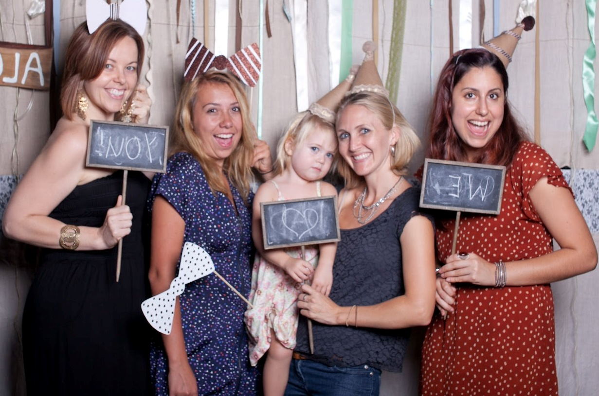 women posing in photobooth