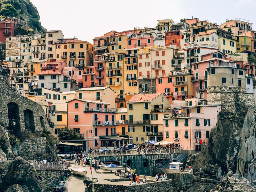 Manarola seen from the seaside. Beauitful and colorful houses facades in Cinque Terre, a popualr summer destination in Europe.