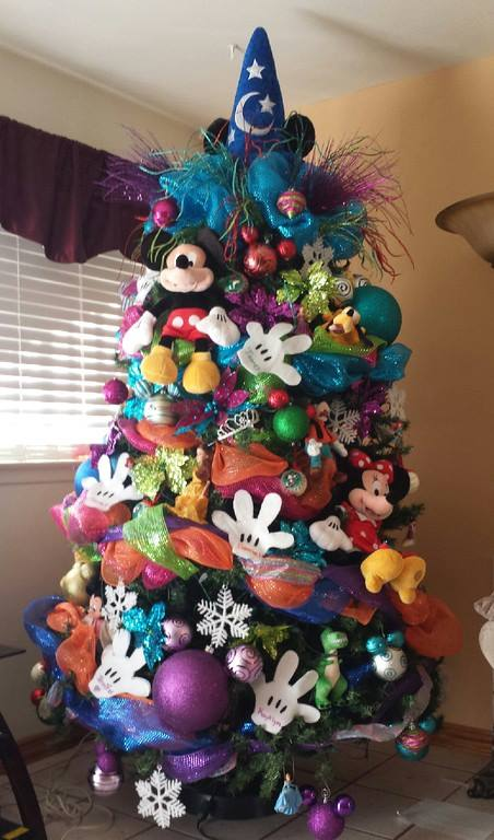 Disney Christmas Tree Perfect for Kids | Want ideas for unique Christmas trees for the 2020 holiday season? Find inspiration ideas for your Christmas tree decoration from creative and unique xmas trees. From white, upside down, best Christmas trees on wall, pink Christmas trees, and even Disney Christmas tree decorations. From big and small unique Christmas tree ideas. Perfect for kids and for the holidays. #uniquechristmastree #christmastreeideas #christmastreeideas #christmas