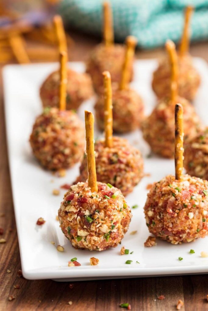 Cheese Ball Bites | Want to serve your guests the best Christmas party appetizers this year? Find a list of 40+ Christmas appetizers ideas & easy recipes for Christmas party appetizers, both sweet and savory holiday food. From elegant Christmas finger food ideas to easy dips, and simple crockpot holiday appetizers, (vegetarian, keto and even gluten-free appetizer ideas), perfect for a crowd and for kids. #christmaspartyappetizers #appetizersforchristmasparty #christmasparty #fingerfood #christmasfood